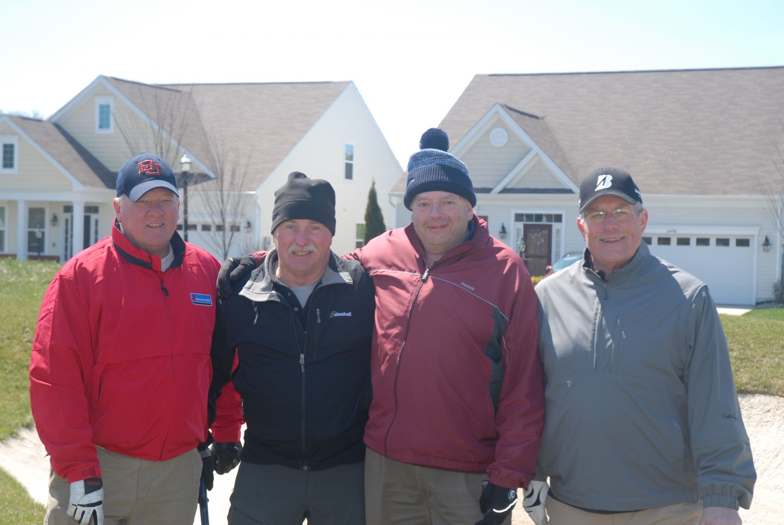 Plantation Lakes Four Golfers outside staying warm